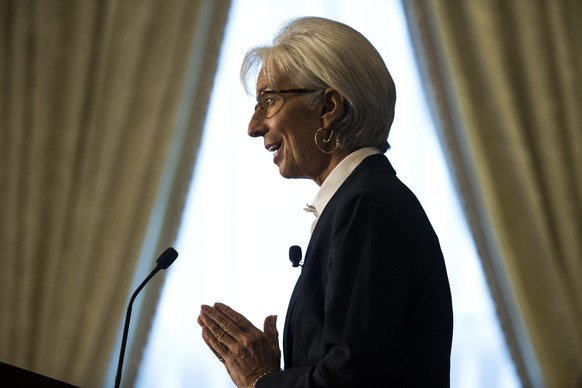 epa05072898 (FILE) A file photograph showing Managing Director of the International Monetary Fund (IMF) Christine Lagarde speaks on the global economy ahead of the IMF/World bank annual meetings at the Willard Hotel in Washington, DC, USA, 30 September 2015. Media reports state that Christine Lagarde is to stand trial in France for alleged negligence over a 400m Euro payment to a businessman in 2008.  EPA/JIM LO SCALZO *** Local Caption *** 52285147