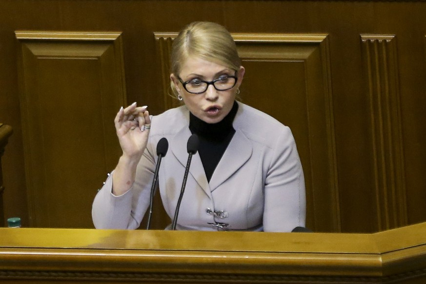 Ukrainian opposition leader Yulia Tymoshenko gestures during a parliament session in Kiev, Ukraine, Monday, Nov. 26, 2018. Ukrainian President Petro Poroshenko has halved his proposal for martial law in the country to 30 days, an apparent concession to opponents. (AP Photo/Efrem Lukatsky)