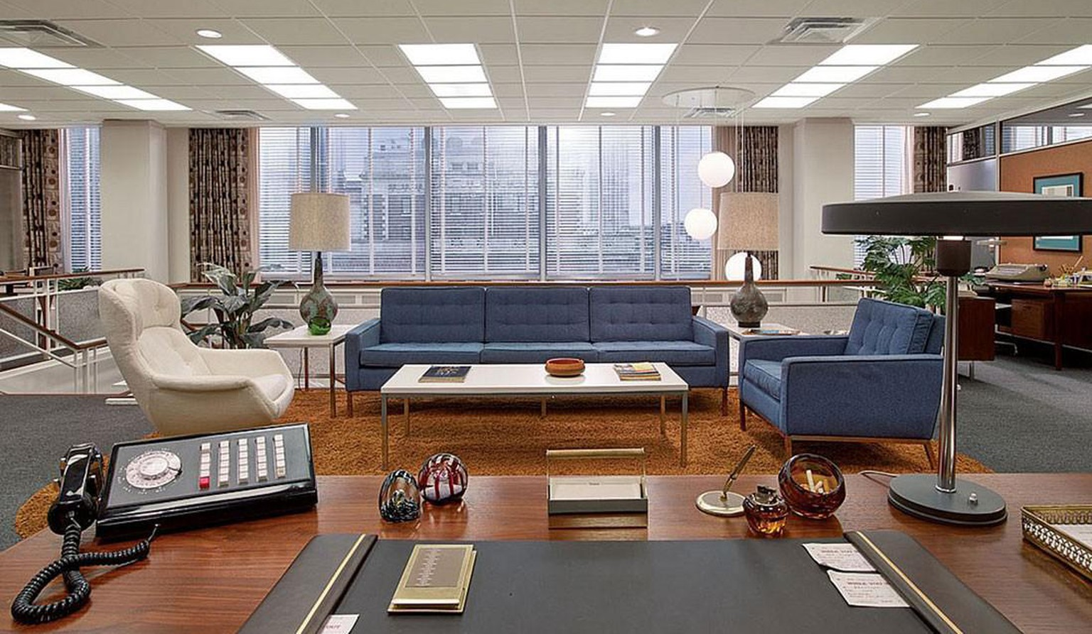 Designed by Florence Knoll in 1954, the eponymous Florence Knoll Sofa (or couch/setee) is distinctive and versatile.  This sofa is seen in many different seater combinations and colours throughout Mad Men and is also available in brown, green, grey, ivory, natural and sand hues, making it a truly versatile addition to your space.  Inspired by the rhythm and proportions of mid-century modern architecture, the Florence Knoll Sofa exhibits a geometric profile, constructed with a solid wood structure and an exposed metal frame, elevated on tubular steel legs.  Iconic designer Florence Knoll's contributions to the world of design are immeasurable, while her inimitable vision over her long illustrious career won her countless awards and accolades, including the National Medal of Arts, awarded by the president, the American Institute of Architects' Industrial Design Gold Medal and the Red Dot Design Award.  https://filmandfurniture.com/product/florence-knoll-3-seat-sofa/