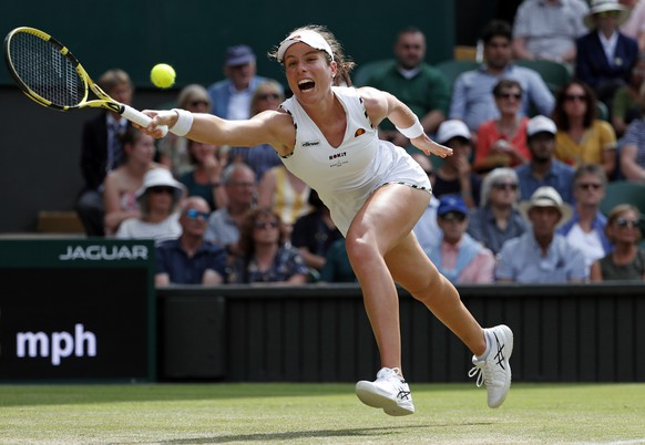 Britain's Johanna Konta returns to Czech Republic's Petra Kvitova in a Women's singles match during day seven of the Wimbledon Tennis Championships in London, Monday, July 8, 2019. (AP Photo/Alastair Grant)