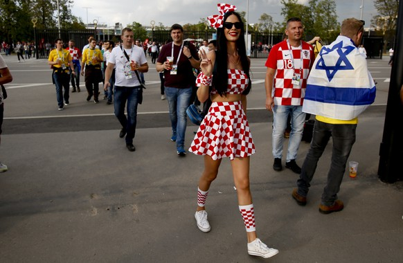 A Croatia fan arrives for the semifinal match between Croatia and England at the 2018 soccer World Cup in the Luzhniki Stadium in Moscow, Russia, Wednesday, July 11, 2018. (AP Photo/Rebecca Blackwell)