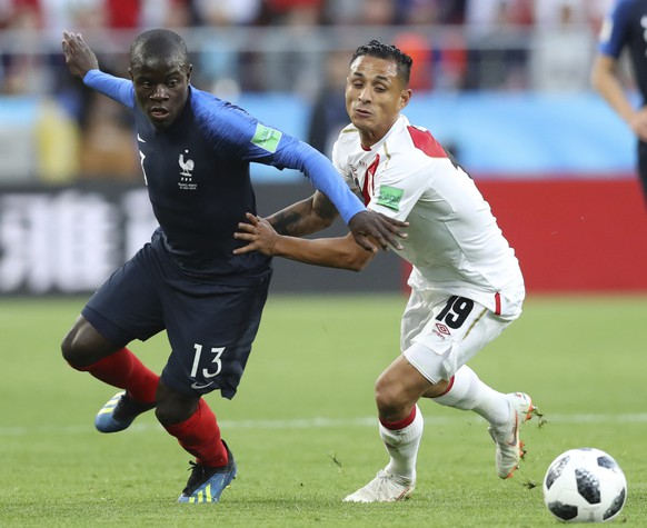 France's Ngolo Kante, left vies for the ball with Peru's Yoshimar Yotun during the group C match between France and Peru at the 2018 soccer World Cup in the Yekaterinburg Arena in Yekaterinburg, Russia, Thursday, June 21, 2018. (AP Photo/David Vincent)