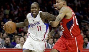 Los Angeles Clippers guard Jamal Crawford, left, is fouled by Atlanta Hawks guard Thabo Sefolosha during the second half of an NBA basketball game in Los Angeles, Monday, Jan. 5, 2015. The Hawks won 107-98. (AP Photo/Chris Carlson)