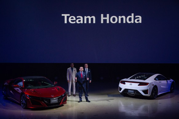 epa05509243 Honda Motor Co. President and CEO Takahiro Hachigo delivers a speech about the company's new second generation NSX sports car during an unveiling event in Tokyo, Japan, 25 August 2016. Honda Motor Co., Ltd. announced today that the company will be accepting orders in Japan for the new NSX sports car, which underwent a full redesign for the first time in 26 years since the first generation of the original NSX. This all new second generation NSX features linear and powerful acceleration and enhanced handling made possible with Sport Hybrid SH-AWD technology. The direct-injected and twin-turbocharged V6 engine with a 9-speed dual clutch transmission makes this NSX a supercar with superior performance, yet comfortable for anyone to drive.  EPA/CHRISTOPHER JUE