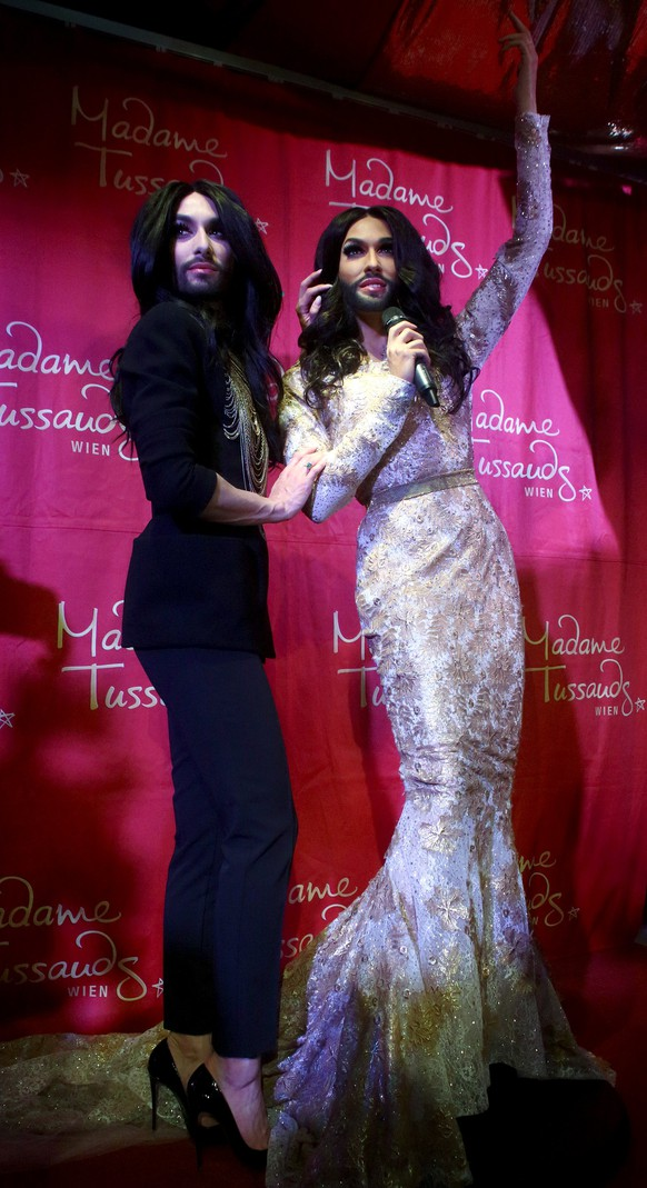 Austrian Eurovision Song Contest winner Conchita Wurst (L) poses after unveiling her wax figure at Madame Tussauds in Vienna, Austria May 12, 2015. REUTERS/Heinz-Peter Bader