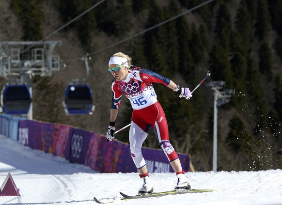 Norway's Therese Johaug skis during the women's 10 km cross-country classic event at the Sochi 2014 Winter Olympic Games in Rosa Khutor February 13, 2014.           REUTERS/Sergei Karpukhin (RUSSIA  - Tags: SPORT SKIING OLYMPICS)