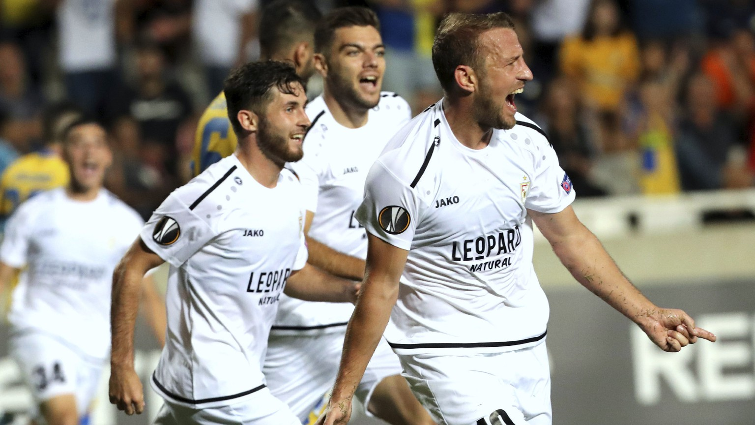 Dudelange's Dominik Stolz, right, celebrates with his teammates his goal against APOEL during the Europa League group A soccer match between APOEL Nicosia and Dudelange at GSP stadium in Nicosia, Cyprus, Thursday, Sept. 19, 2019. (AP Photo/Petros Karadjias)