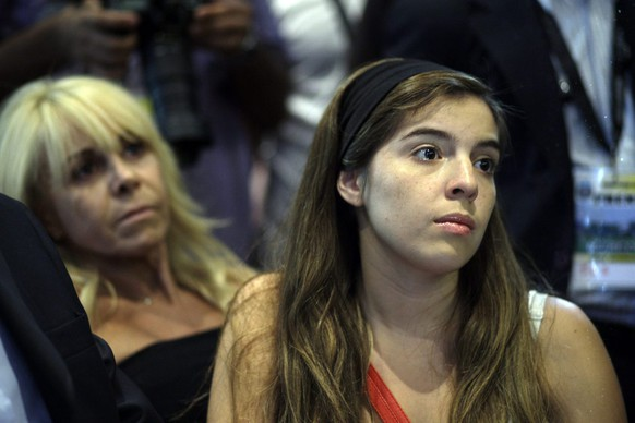 Diego Maradona's daughter Dalma Maradona, right, and his former wife Claudia Villafane, background left, looks on during press conference of new Argentina's soccer head coach Diego Maradona, not in picture, at the Argentine Football Association in Buenos Aires, Tuesday Nov. 4, 2008. Maradona replaces Alfio Basile, who stepped down Oct. 16, one day after a historic 1-0 loss against neighboring Chile in World Cup qualifiers. Maradona's coaching team has still not been officially announced. (AP Photo/Natacha Pisarenko)