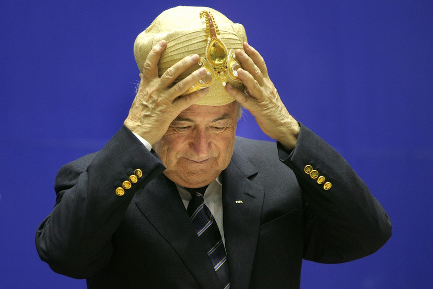 Federation of International football Association, FIFA, President Joseph Sepp Blatter, gestures after being presented with a traditional Indian headgear at the 70th Anniversary of Indian Football, in New Delhi, India, Tuesday, April 17, 2007. Blatter, who is on a four day visit to India, is the first FIFA chief to come on an official visit to the country, according to a news agency. (AP Photo/Manish Swarup)