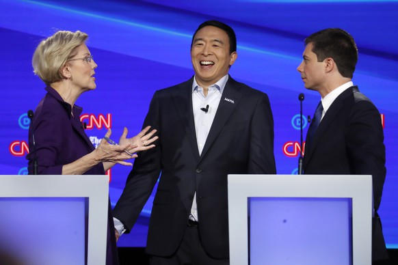 Sen. Elizabeth Warren, D-Mass., left, entrepreneur Andrew Yang, center, and South Bend Mayor Pete Buttigieg talk during break in the Democratic presidential primary debate hosted by CNN/New York Times at Otterbein University, Tuesday, Oct. 15, 2019, in Westerville, Ohio. (AP Photo/John Minchillo) Andrew Yang,Elizabeth Warren,Pete Buttigieg