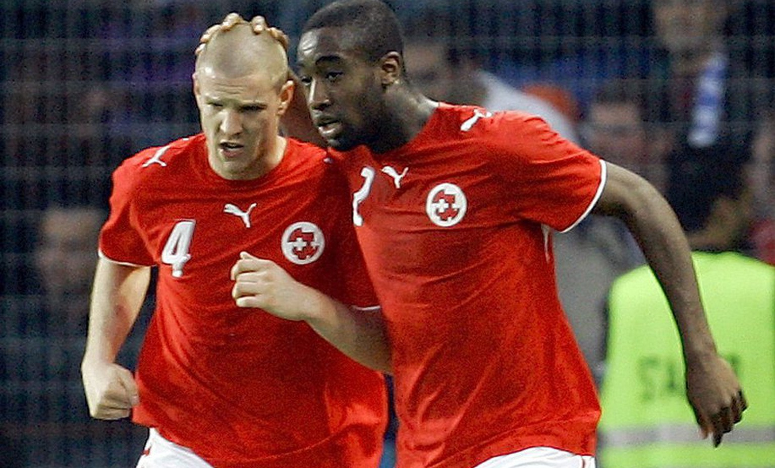 Switzerland's Philippe Senderos, left, celebrates with Johan Djourou, right, Italy's after Switzerland scored during a friendly soccer match in preparation for the upcoming Soccer World Cup between Italy and Switzerland at the Stade de Geneve, in Geneva, Switzerland, Wednesday, May 31, 2006. Italy will play in Group E against Ghana,USA and Czech Republic. Switzerland will play in group G with France, Republic of Korea and Togo. (KEYSTONE/AP Photo/Anja Niedringhaus)