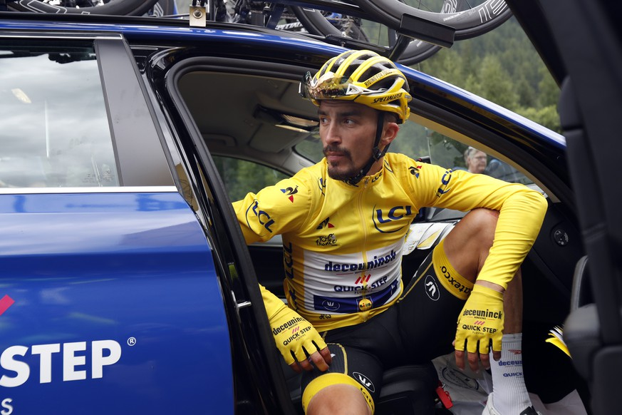 France's Julian Alaphilippe wearing the overall leader's yellow jersey sits in the team director car during the nineteenth stage of the Tour de France cycling race over 126,5 kilometers (78,60 miles) with start in Saint Jean De Maurienne and finish in Tignes, France, Friday, July 26, 2019. Tour de France organizers stopped Stage 19 of the race because of a hail storm as Julien Alaphilippe lost his yellow jersey to Egan Bernal. (AP Photo/Thibault Camus)