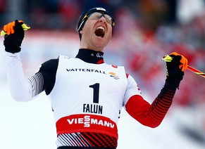 Bernhard Gruber of Austria celebrates winning the Nordic Combined individual Gundersen large hill 10 km event at the Nordic World Ski Championships in Falun February 26, 2015.                  REUTERS/Kai Pfaffenbach (SWEDEN  - Tags: SPORT SKIING TPX IMAGES OF THE DAY)