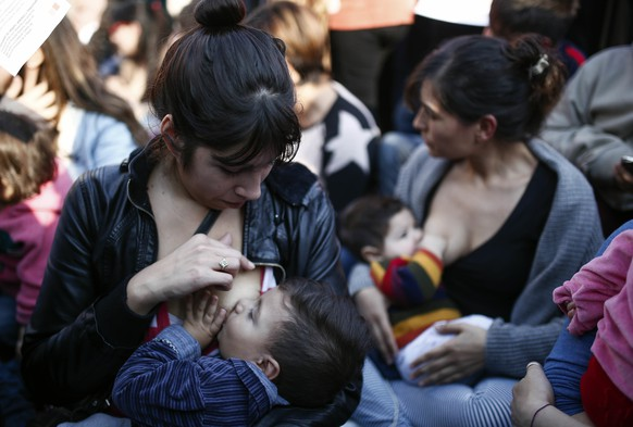 Women breastfeed during a demonstration in support of breastfeeding in public, in Buenos Aires, Argentina, Saturday, July 23, 2016. The rally was organized after a woman was ejected last week from a public park by municipal police officers after she refused to stop breastfeeding her child. (AP Photo/Agustin Marcarian)