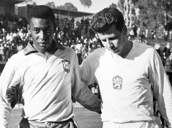 FILE - In this Feb. 1962, file photo, shows Edson Arantes do Nascimento known as Pele, center, trainer Mario Americo, left, and Czech player Masopust.  After Neymar's injury in this 2014 Soccer World Cup while playing against Colombia, Brazil remembers when Pele, its best player in the Chile 1966 World Cup was also sidelined because of injury in the tournament, and Brazil still won the title. (AP Photo, File)