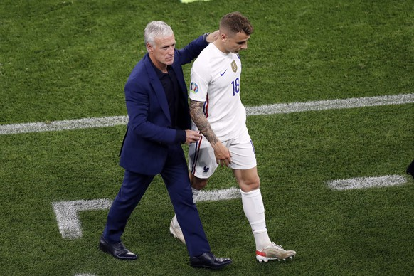 France's manager Didier Deschamps, left, greets France's Lucas Digne (18) after he was taken out of the game during the Euro 2020 soccer championship group F match between Portugal and France at the Ferenc Puskas stadium in Budapest, Hungary, Wednesday, June 23, 2021. (AP Photo/Laszlo Balogh, Pool)