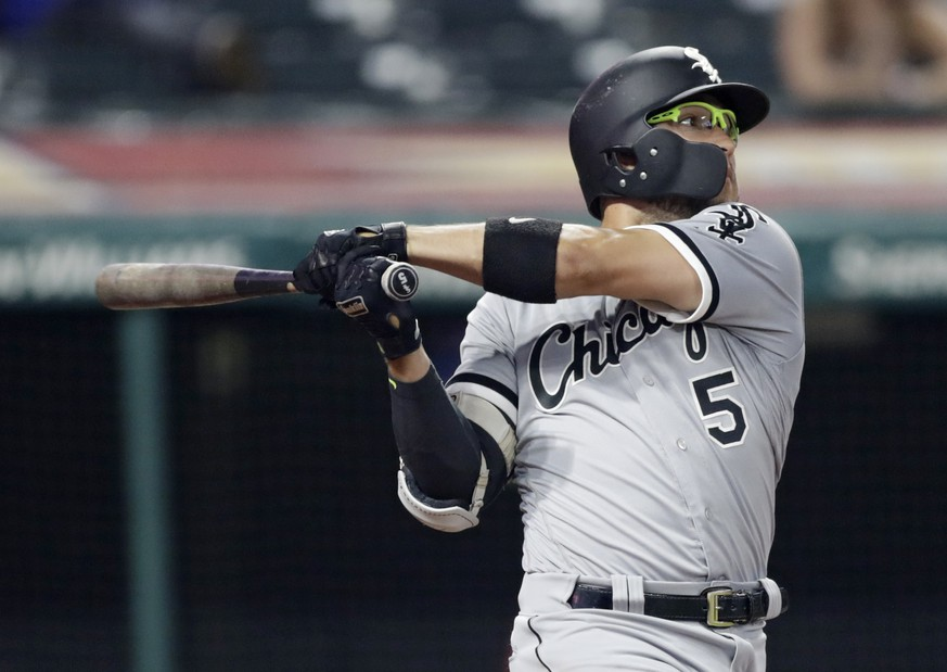 Chicago White Sox's Yolmer Sanchez hits an RBI-single off Cleveland Indians relief pitcher Evan Marshall in the eighth inning of a baseball game, Monday, June 18, 2018, in Cleveland. Adam Engel scored on the play. (AP Photo/Tony Dejak)