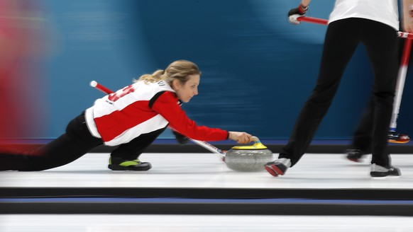 Switzerland's skip Silvana Tirinzoni prepares to launch the stone during their women's curling match against Britain at the 2018 Winter Olympics in Gangneung, South Korea, Monday, Feb. 19, 2018. (AP Photo/Aaron Favila)