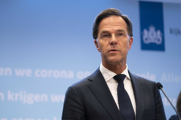 epa08870909 Dutch Prime Minister Mark Rutrte speaks at a press conference in The Hague, The Netherlands, 08 December 2020 There may be stricter measures before Christmas if the coronavirus related figures continue to rise, Rutte said during the media briefing about the latest developments in connection with the coronavirus pandemic in the Netherlands.  EPA/BART MAAT