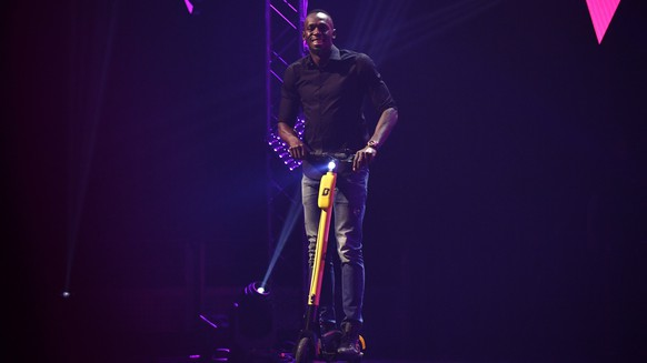 epa07575970 Jamaican eight-time Olympic sprint champion Usain Bolt presents his new electric scooter at the Vivatech startups and innovation fair, in Paris, France, 16 May 2019. Acording to organizers, VivaTech is the 'world's rendezvous for startups and leaders to celebrate innovation'. It aims to gather the world's brightest minds, talents, and products taking place in Paris on 16 to 18 May 2019.  EPA/Julien de Rosa