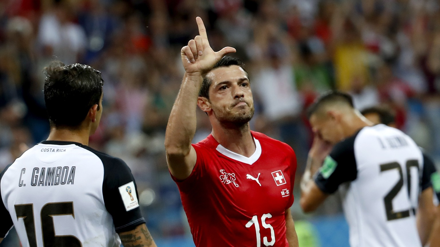 epa06845432 Blerim Dzemaili (C) of Switzerland celebrates scoring the opening goal during the FIFA World Cup 2018 group E preliminary round soccer match between Switzerland and Costa Rica in Nizhny Novgorod, Russia, 27 June 2018.