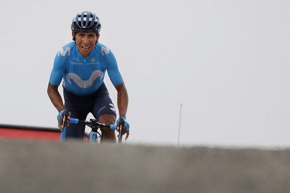 epa06910019 Movistar team rider Nairo Quintana of Colombia approaches the finish line to win the 17th stage of the 105th edition of the Tour de France cycling race over 65km between Bagneres de Luchon and Saint Lary Soulan col du Portet, France, 25 July 2018.  EPA/SEBASTIEN NOGIER