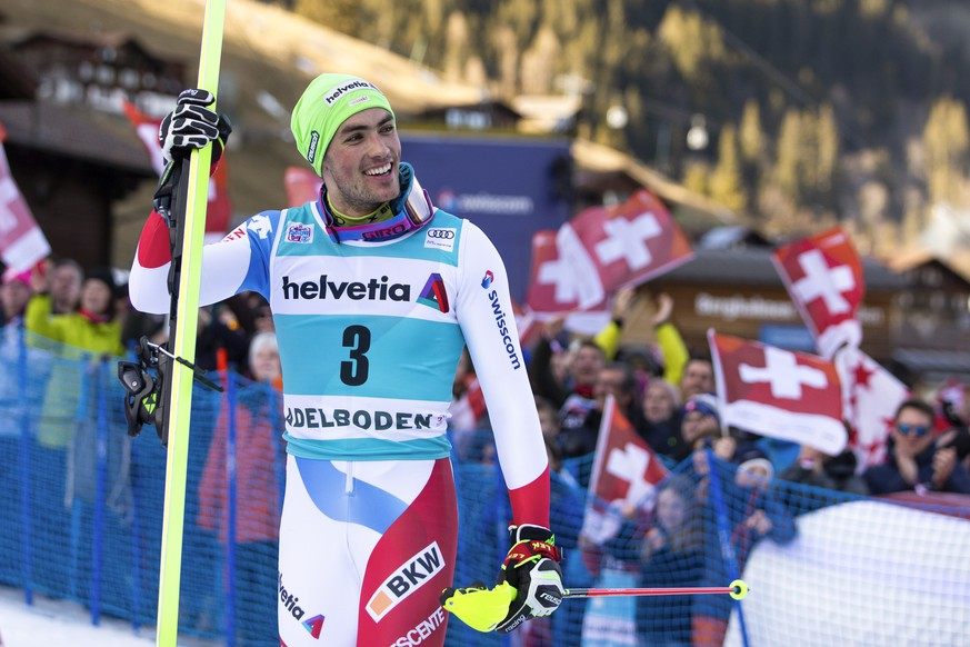 Winner Daniel Yule of Switzerland celebrates on his way to the podium after the men's slalom FIS World Cup race in Adelboden, Switzerland, Sunday, January 12, 2020. (KEYSTONE/Peter Klaunzer)