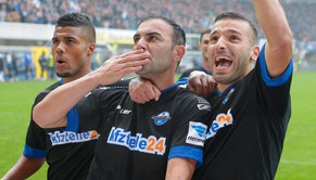 PADERBORN, GERMANY - APRIL 27:  (L-R) Elias Kachunga, Mahir Saglik and Sueleyman Koc celebrate their teams second goal during the Second Bundesliga match between SC Paderborn and SV Sandhausen at Benteler Arena on April 27, 2014 in Paderborn, Germany.  (Photo by Thomas Starke/Bongarts/Getty Images)