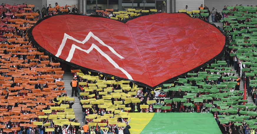 Leipzig fans celebrate with a heart during the German first division Bundesliga soccer match between RB Leipzig and Bayer 04 Leverkusen in Leipzig, Germany, Saturday, April 8, 2017. (AP Photo/Jens Meyer)