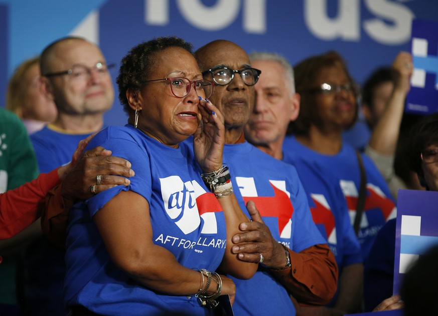 A woman cries as she listens to Democratic presidential candidate Hillary Clinton speak at a United Food and Commercial Workers International Union hall, Wednesday, May 25, 2016, in Buena Park, Calif. (AP Photo/John Locher)