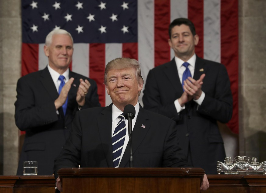 US Vice President Mike Pence (L) and Speaker of the House Paul Ryan (R) applaud as US President Donald J. Trump (C) arrives to deliver his first address to a joint session of Congress from the floor of the House of Representatives in Washington, DC, USA, 28 February 2017.  REUTERS/Jim Lo Scalzo