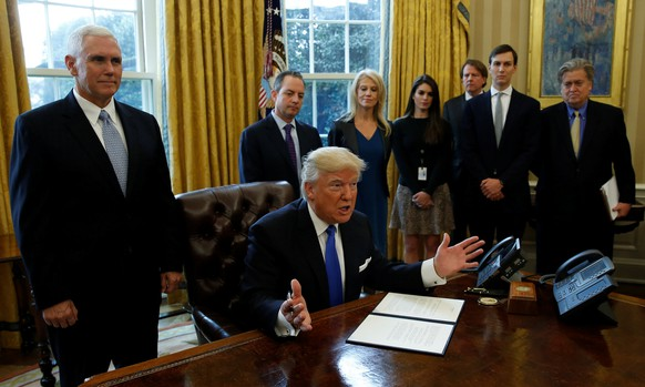 U.S. President Donald Trump speaks to reporters while signing an executive order to advance construction of the Keystone XL pipeline at the White House in Washington January 24, 2017.  REUTERS/Kevin Lamarque