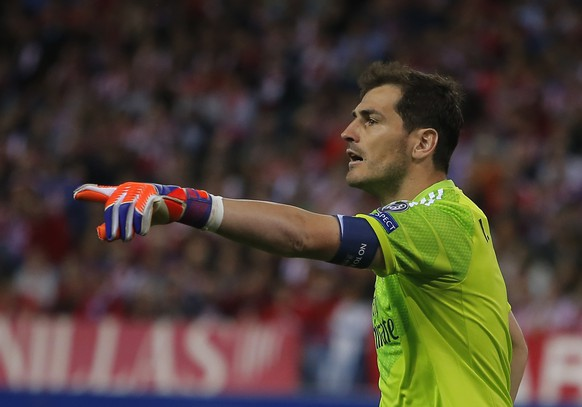 Real Madrid's goalkeeper Iker Casillas reacts during the Champions League quarterfinal first leg soccer match between Atletico Madrid and Real Madrid at the Vicente Calderon stadium in Madrid, Spain, Tuesday, April 14, 2015. (AP Photo/Andres Kudacki)