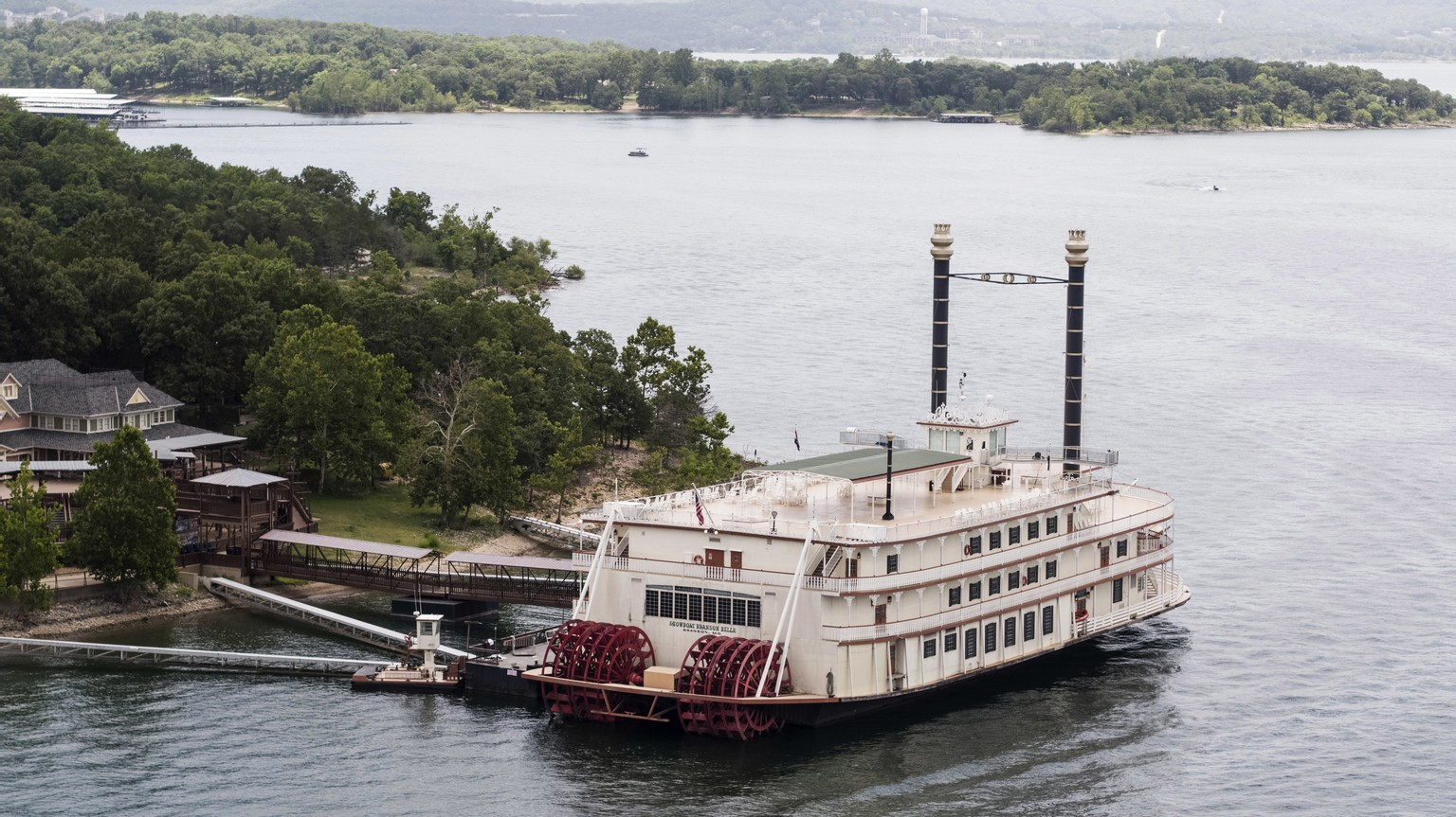 This photo shows a Showboat Branson Belle riverboat docked on Table Rock Lake near Branson, Mo., Friday, July 20, 2018, a day after a duck boat capsized and sank in the lake. Stone County Sheriff Doug Rader said Friday an off-duty deputy aboard a nearby Showboat Branson Belle and others on the riverboat jumped in to help the duck boat's passengers. He described the rescue effort as