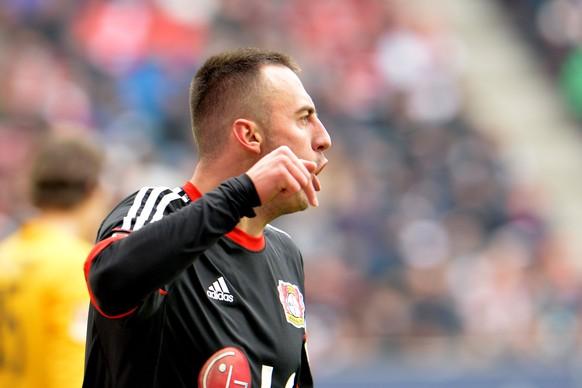 Leverkusen's Josip Drmic from Switzerland celebrates after scoring during the  Bundesliga  soccer match between FC Augsburg and Bayer 04 Leverkusen in the SGL Arena in Augsburg, Germany, on Saturday, Feb. 21, 2015. (AP Photo/Kerstin Joensson)