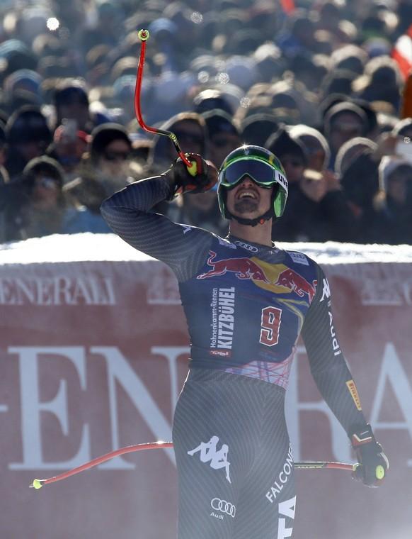 Italy's Dominik Paris celebrates after completing an alpine ski, men's World Cup downhill, in Kitzbuehel, Austria, Saturday, Jan. 21, 2017. (AP Photo/Giovanni Auletta)