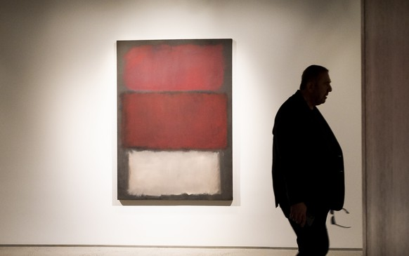 epa07544864 A man walks past the 1960 painting 'Untitled' by Mark Rothko, estimated to sell for 35-50 million USD, during a preview of upcoming 'Impressionist and Modern Art' and 'Contemporary Art' auctions at Sotheby's in New York, New York, USA, 03 May 2019. The auctions take place in the middle of May.  EPA/JUSTIN LANE