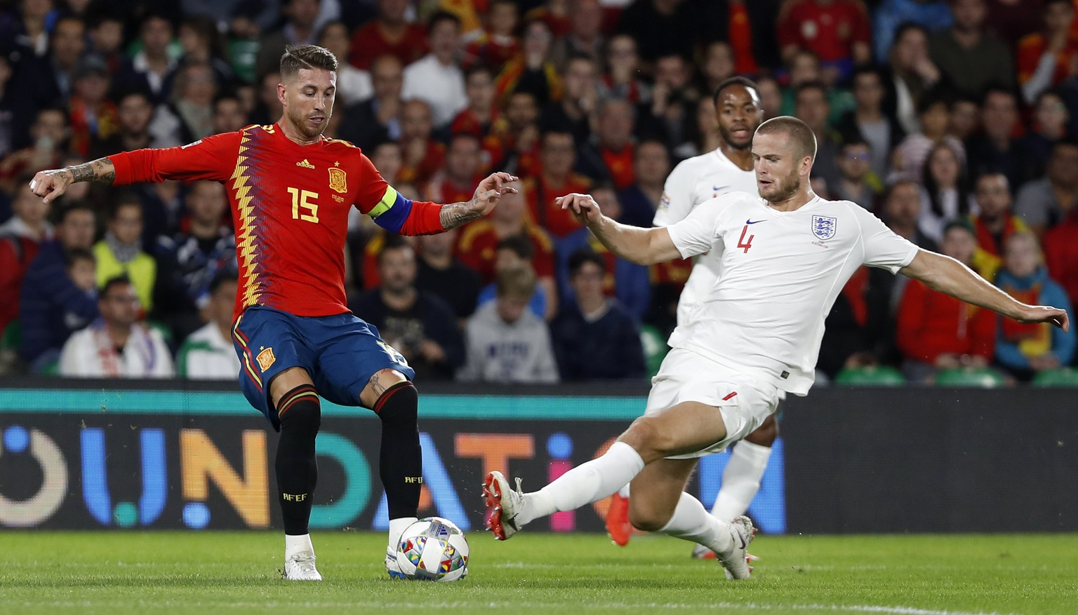 England's Eric Dier, right, stops Spain's Sergio Ramos during the UEFA Nations League soccer match between Spain and England at Benito Villamarin stadium, in Seville, Spain, Monday, Oct. 15, 2018. (AP Photo/Miguel Morenatti)
