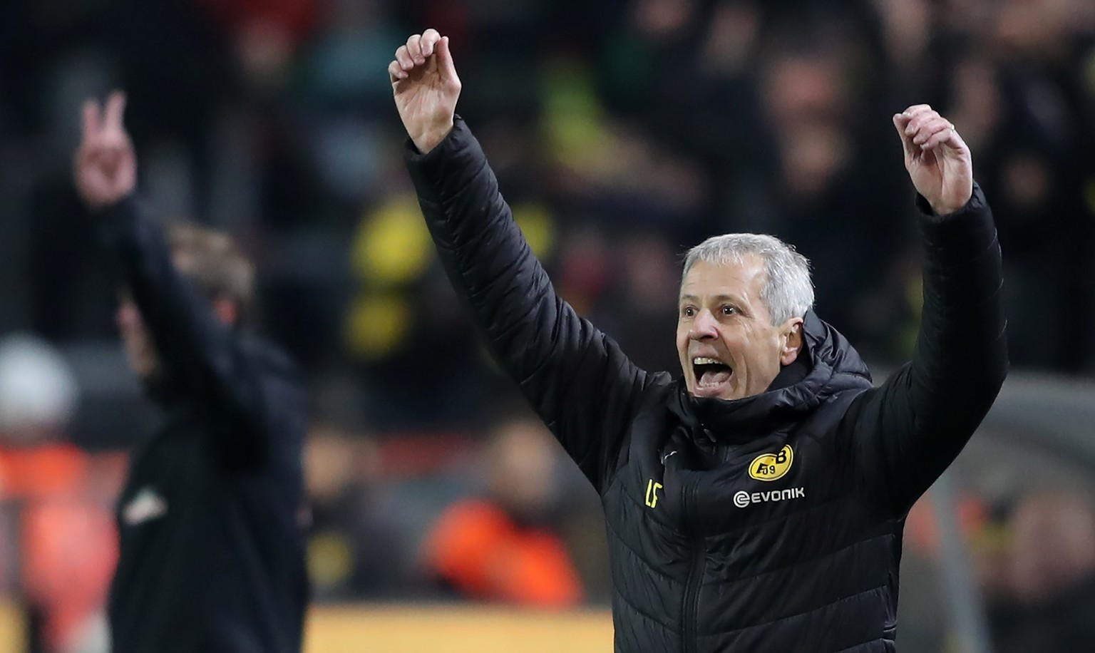 epa07234180 Dortmund's head coach Lucien Favre (R) celebrates during the German Bundesliga soccer match between Borussia Dortmund and SV Werder Bremen in Dortmund, Germany, 15 December 2018.  EPA/FRIEDEMANN VOGEL CONDITIONS - ATTENTION:  The DFL regulations prohibit any use of photographs as image sequences and/or quasi-video.