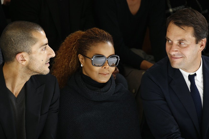 REFILE - CORRECTING POSITION Artist Janet Jackson (C) and her husband  Wissam Al Mana (L) attend the Hermes Spring/Summer 2016 women's ready-to-wear collection show in Paris, France, October 5, 2015. REUTERS/Benoit Tessier