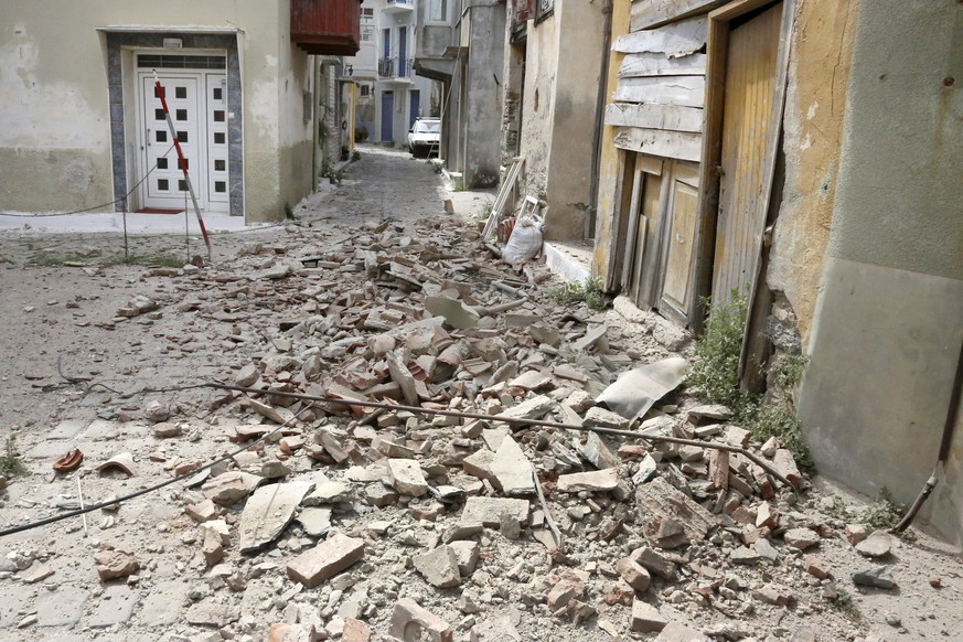 epa06024472 Damage in Plomari village after a strong earthquake struck Lesvos island, in Greece, 12 June 2017. A strong earthquake measuring at least 6.1 on the Richter scale shook Lesvos island at 15:28 (local time) as measured by the Geodynamic Institute in Athens, or 6.3 on the Richter scale according to the European-Mediterranean Seismological Centre (EMSC). The epicentre of the quake was located in the sea 14 km south of Plomari and 34 km from Mytilene, between the island and the coast of Turkey. According to initial reports from the island, the quake has caused damage to buildings in the south and the collapse of old houses in the village of Plomari, as well as the dome on Agios Panteleimonas Church. The central road from Mytilene to Plomari and Melinta is closed due to rockfall near Agios Isidoros while Plomari Deputy Mayor Manolis Armenakas said damage has been reported in the village of Plagia.  EPA/MANOLIS LAGOUTARIS