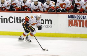 Calgary Flames' Sven Baertschi of Switzerland takes the puck past his teammates in the third period of an NHL hockey game against the Minnesota Wild Tuesday, Feb. 26, 2013, in St. Paul, Minn. The Wild won 2-1 in overtime. (AP Photo/Jim Mone)
