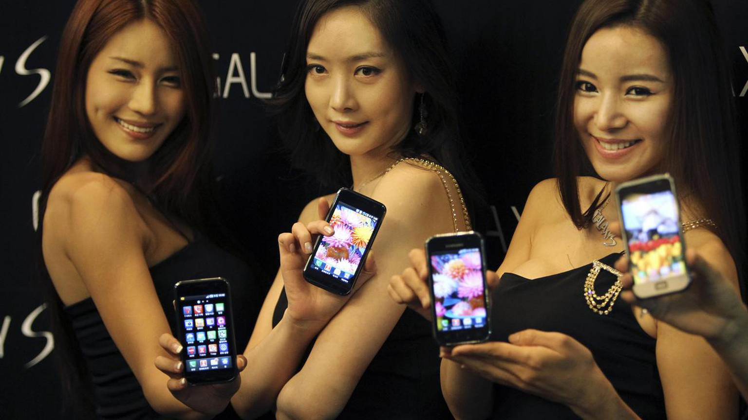 Models display Samsung's new Galaxy phones running Google's new operating system Android at the Samsung headquarters during a media launch Tuesday, June 8, 2010, in Seoul, South Korea.  (AP Photo/Wally Santana)
