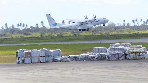 FILE - In this March, 31, 2019 file photo, a World Food Programme(WFP) plane takes off from Beira International Airport after dropping off supplies for survivors of Cyclone Idai in Beira, Mozambique. In the wake of an internal survey that detailed multiple allegations of rape and sexual harassment of its female staffers, David Beasley, the agency's executive director, vowed to go after abusers. Beasley said over the past year he has been increasing the number of investigators at the agency to 22 to look into allegations of misconduct, including a number who specialize in dealing with victims of sexual violence. (AP Photo/Tsvangirayi Mukwazhi, File)