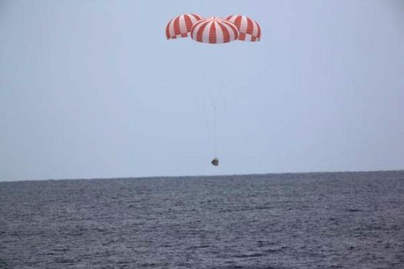 In this photo released by SpaceX, a SpaceX capsule containing science samples from NASA's one-year space station resident, approaches the Pacific Ocean, a few hundred miles off the Southern California coast, Wednesday, May 11, 2016. Nearly 4,000 pounds of items fill the Dragon, including blood and urine samples from astronaut Scott Kelly's one-year mission. Kelly returned to Earth in March and has since retired from NASA. Researchers will use the medical specimens to study how the body withstands long journeys in space, in preparation for an eventual mission to Mars in the 2030s.  (SpaceX via AP)