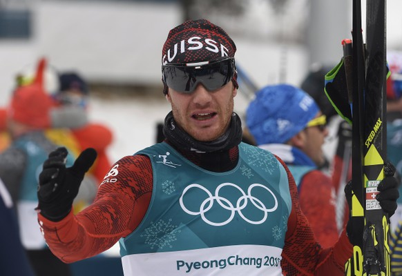 epa06514105 6th placed Dario Cologna of Switzerland reacts after the Men's Cross Country 15 km + 15 km Skiathlon race at the Alpensia Cross Country Centre during the PyeongChang 2018 Olympic Games, South Korea, 11 February 2018.  EPA/FILIP SINGER