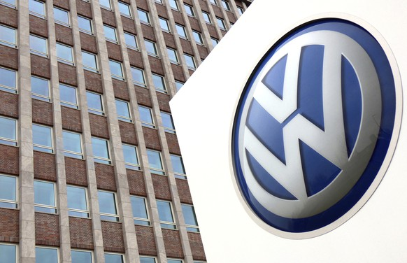 FILE - In this Friday, April 13, 2018 file photo, a Volkswagen logo is pictured in front of a company building in Wolfsburg, Germany. A German consumer group has filed a suit against Volkswagen that aims to establish a right to compensation for car owners affected by the automaker's diesel emissions scandal. (AP Photo/Michael Sohn, File)