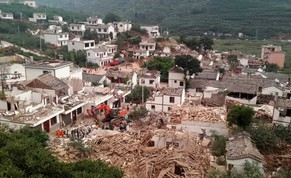 A general view shows collapsed houses after an earthquake hit Ludian county, Yunnan province August 3, 2014. A magnitude 6.5 earthquake struck southwestern China on Sunday, killing at least 150 people in a remote mountainous area of Yunnan province, causing some buildings, including a school, to collapse, Xinhua News Agency reported. REUTERS/China Daily (CHINA - Tags: DISASTER ENVIRONMENT TPX IMAGES OF THE DAY) CHINA OUT. NO COMMERCIAL OR EDITORIAL SALES IN CHINA