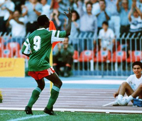 NAPLES, ITALY - JUNE 23: Roger Milla of Cameroon celebrates scoring his first goal during the World Cup eighth final match between Cameroon and Colombia at the San Paolo Stadium on June 23, 1990 in Naples, Italy. (Photo by Henri Szwarc/Bongarts/Getty Images)