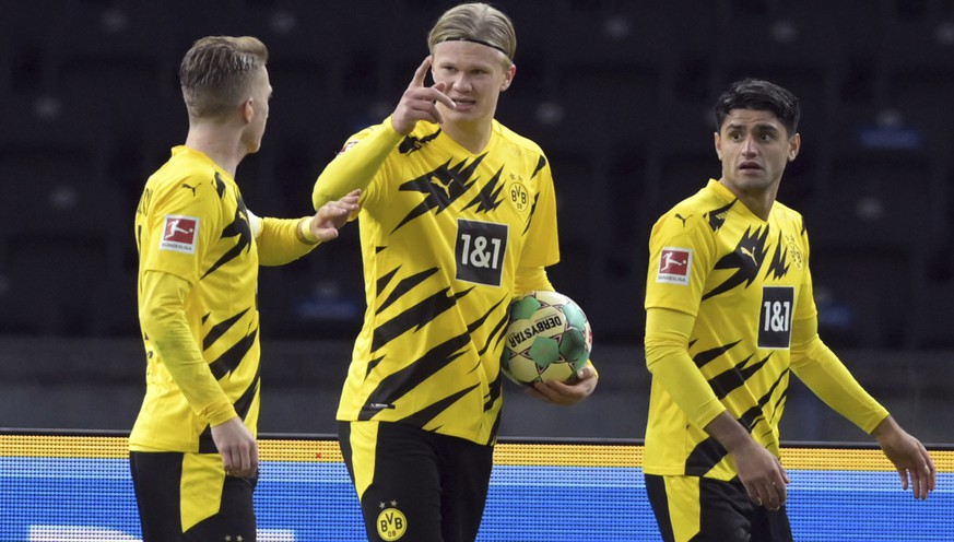 Dortmund's Erling Haaland celebrates after his goal during a German Bundesliga soccer match between Hertha BSC Berlin and Borussia Dortmund in Berlin, Geremany, Saturday, Nov.21, 2020. (Soeren Stache/dpa via AP)